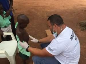 Peter and Hungarian doctors in Kapeke, Uganda