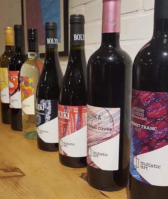 Hungarian wine bottles decorated with autistic art