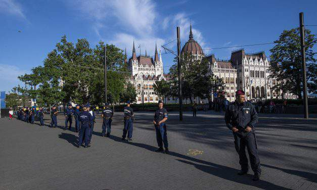 Police escort demonstrators out of Kossuth Square during the new parliament's inaugural session