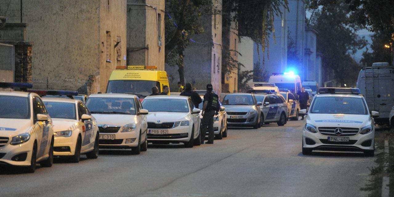 Police take 14 people into custody after drug raid