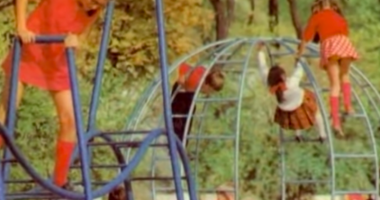 children playing on a playground in 1970-80