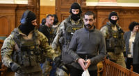 Hassan F. Syrian accused of mass murders denies charges