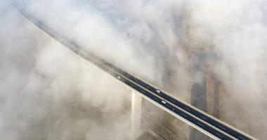 valley bridge in fog