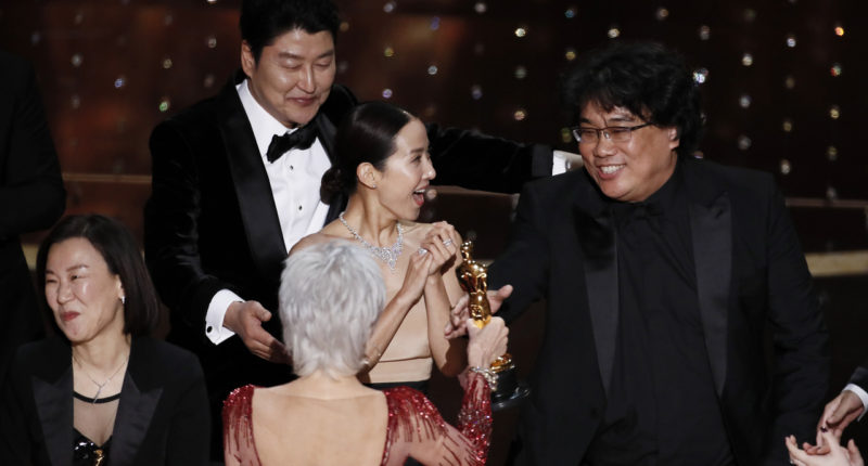 South Korea's Bong Joon-ho wins Best Director for Parasite. Photo: MTI/EPA/Etienne Laurent