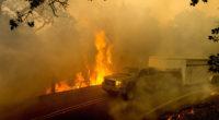 A wildfire spreading rapidly through the rural area of Santa Clarita