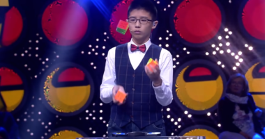 rubik's cube juggling boy