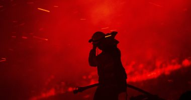 Raging wildfires injure 2 firefighters in California, force massive evacuations