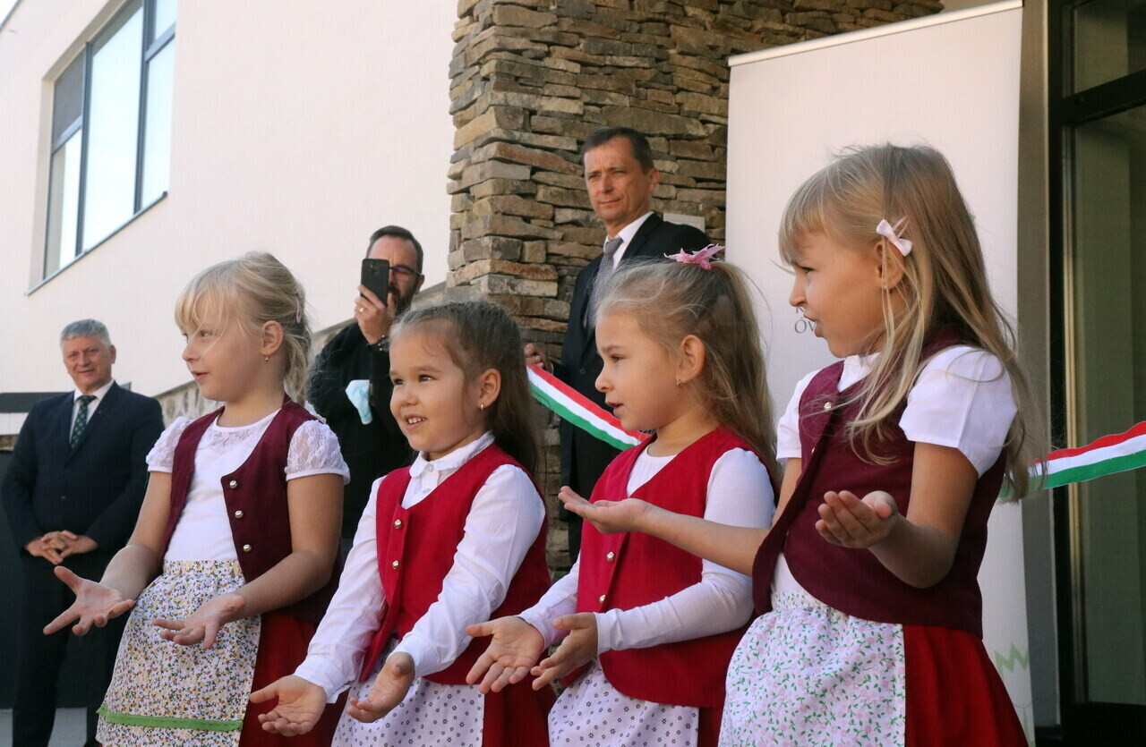 Children perform at the inauguration of the new kindergarten and nursery of the local Reformed parish in Királyhelmec